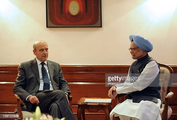 French Minister for Foreign Affairs and European Affairs, Alain Juppe talks with Indian Prime Minister Manmohan Singh during a meeting in New Delhi...
