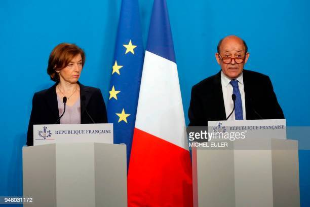 TOPSHOT French Minister for Foreign Affairs JeanYves Le Drian and French Defense Minister Florence Parly make an official statement in the press room...