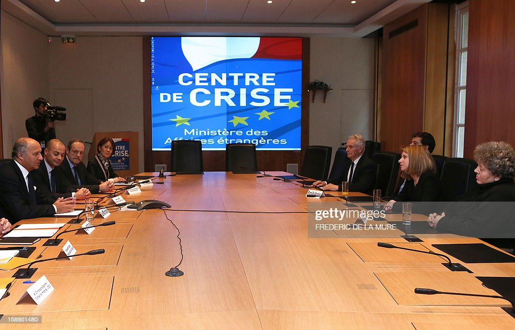 French Minister for Foreign Affairs Laurent Fabius (L) meets on January 4, 2013, at the Foreign Affairs Ministry in Paris, with relatives of Serge Lazarevic and Philippe Verdon, two French men who were taken as hostages in Mali on November 24, 2011.