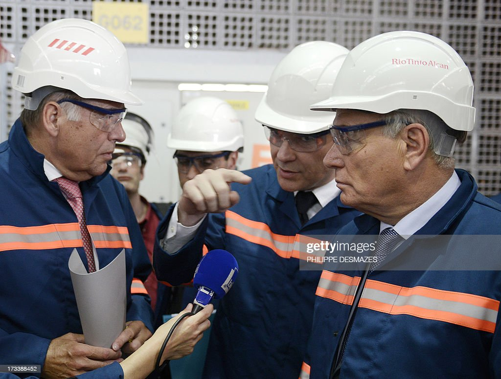 French Minister for Industrial Renewal and Food Industry Arnaud Montebourg (C) talks with French Prime minister Jean-Marc Ayrault (R) and German Heinz-Peter Schlüter (L), president of TRIMET as they visit the Rio Tinto Alcan (RTA) aluminum factory in Saint-Jean-de-Maurienne, southeast of France, on July 13, 2013. Heads of Rio Tinto Alcan and Germany's Trimet met today in Paris regarding the take over of RTA by Trimet which could save 510 jobs at the two sites of Saint-Jean-de-Maurienne (Savoie) and Castelsarrasin (Tarn-et-Garonne) .