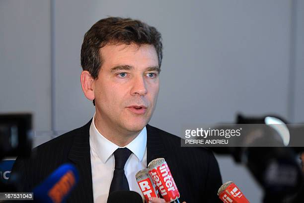 French Minister for Industrial Renewal Arnaud Montebourg answers the media after giving a press conference on April 26 2013 in Paris following the...