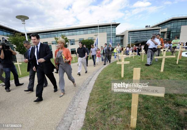 French minister for Industry Christian Estrosi leaves after a visit to the Nortel plant factory in Chateaufort, outside Paris, on July 15, 2009 after...
