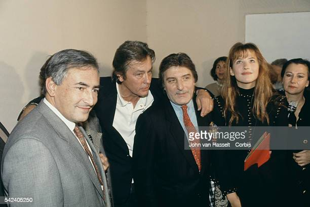 French Minister for Industry Dominique StraussKahn actor Alain Delon fashion designer and actress Sophie Marceau attend the 1993 Spring Summer Pret a...