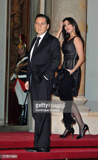 French minister for industry Energy and the Digital Economy Eric Besson and his wife Yasmine pose as they arrive to the State Dinner At Elysee Palace...