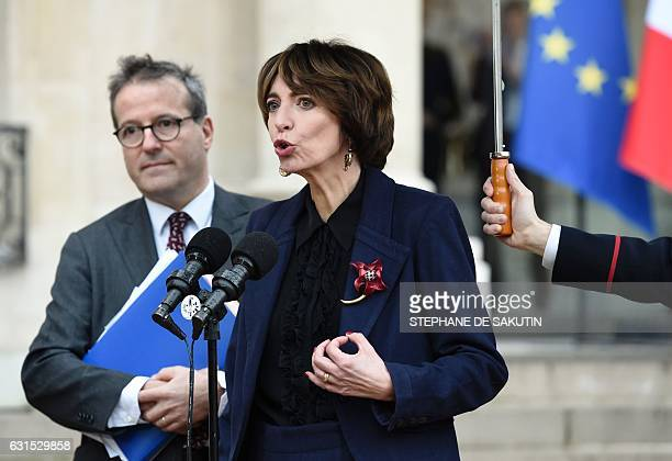French Minister for Social Affairs and Health Marisol Touraine and director of Paris' public assistance hospitals APHP Martin Hirsch speak to...
