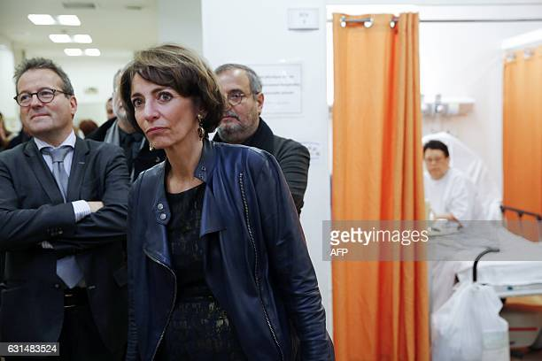 French Minister for Social Affairs and Health Marisol Touraine flanked by director of Paris' public assistance hospitals APHP Martin Hirsch visits...