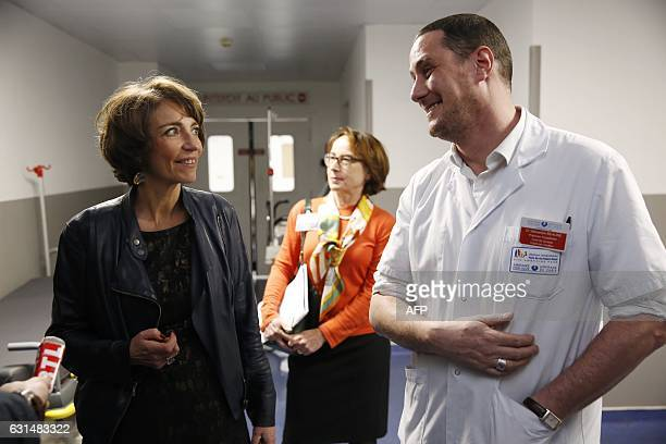 French Minister for Social Affairs and Health Marisol Touraine speaks with the chief of emergency service Sebastien Beaune during a visit at the...