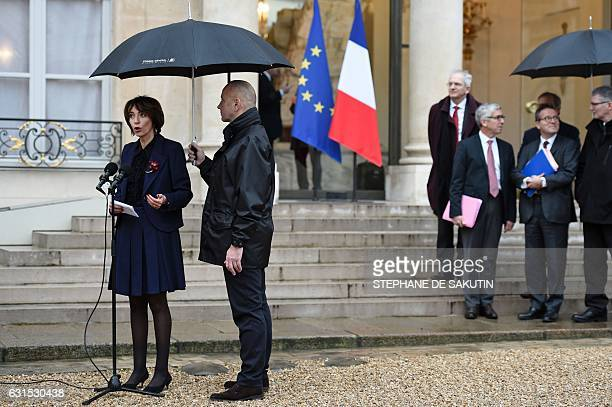 French Minister for Social Affairs and Health Marisol Touraine speaks to journalists as Director of Paris' public assistance hospitals APHP Martin...