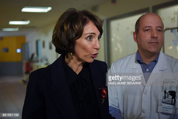 French Minister for Social Affairs and Health Marisol Touraine speaks to the press as she visits the emergency department of the hospital Trousseau...