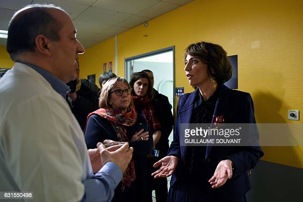 French Minister for Social Affairs and Health Marisol Touraine talks with a doctor as she visits the emergency department of the hospital Trousseau...