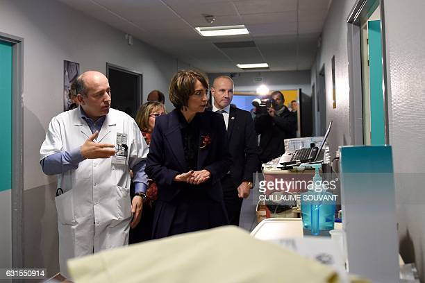 French Minister for Social Affairs and Health Marisol Touraine listens to a doctor as she visits the emergency department of the hospital Trousseau...