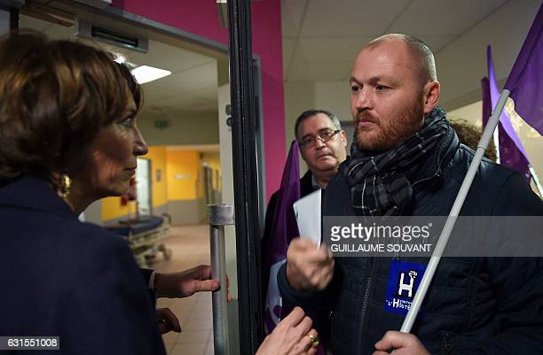 French Minister for Social Affairs and Health Marisol Touraine listens to a man as she visits the emergency department of the hospital Trousseau in...