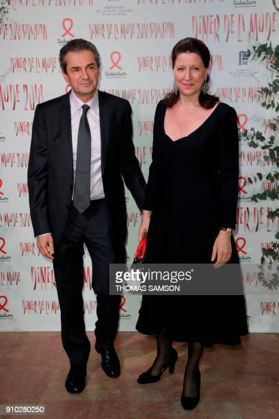 French Minister for Solidarity and Health Agnes Buzyn and French professor Yves Levy poses upon arriving to the Diner de la Mode fundraiser dinner to...