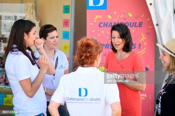 French Minister for Solidarity and Health Agnes Buzyn visits the Solidays music festival on June 23, 2017 at the Longchamp Hippodrome in Paris. The...