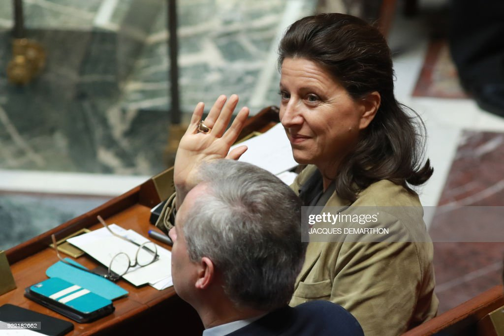 French Minister for Solidarity and Health Agnes Buzyn waves as she attends a session of questions to the government at the National Assembly in Paris on February 21, 2018