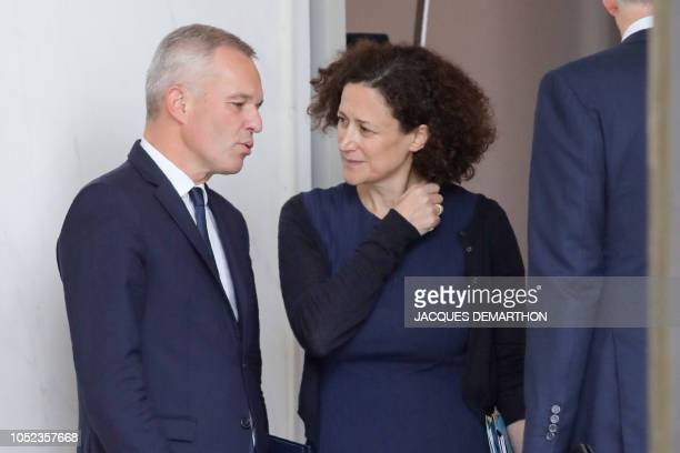 French Minister for the Ecological and Inclusive Transition Francois de Rugy speaks with his deputy minister Emmanuelle Wargon as they leave the...