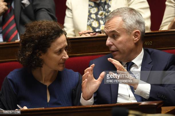 French Minister for the Ecological and Inclusive Transition Francois de Rugy speaks with his deputy minister Emmanuelle Wargon during a session of...