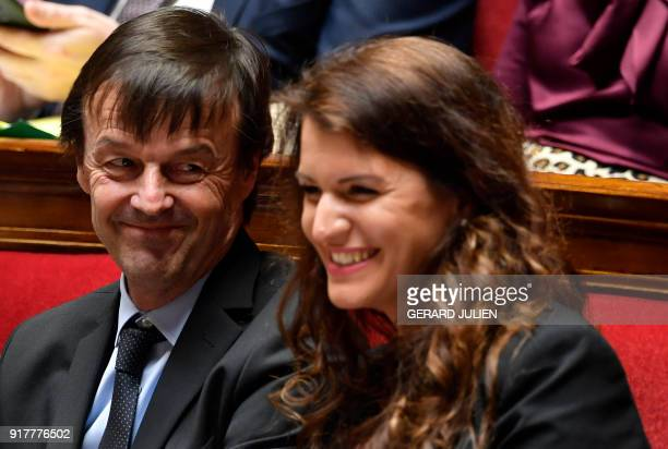 French Minister for the Ecological and Inclusive Transition Nicolas Hulot reacts as he sits next to French Junior Minister for Gender Equality...