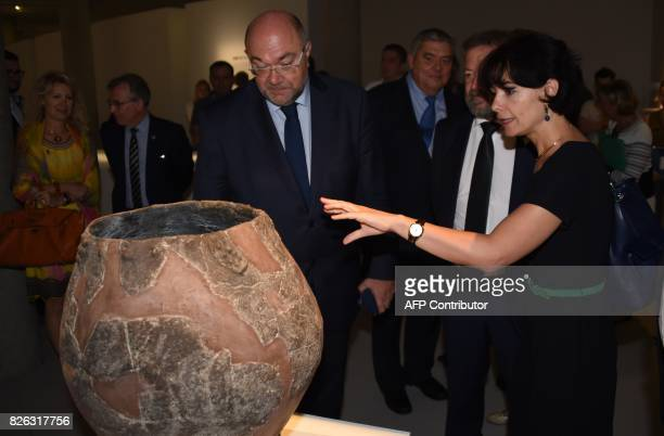 French Minister of Agriculture Stéphane Travert looks at a terracotta wine jar or kvevris from Georgia dating from 6BC which sits on display at an...