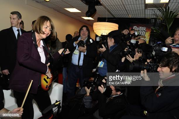 French Minister of Culture Christine Albanel Launches the 43rd edition of the Midem Music Market and testes her virtuosity at the 'Guitar Hero' game