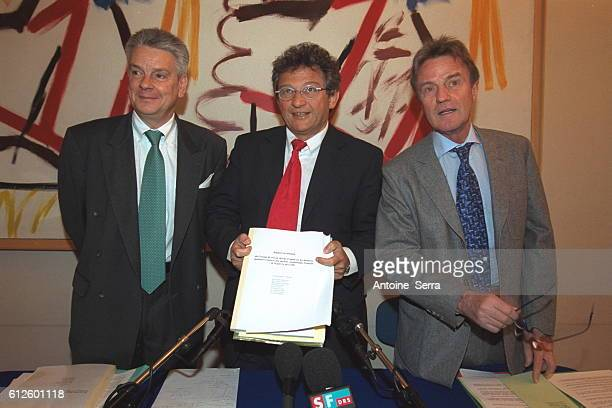French minister of defense Alain Richard stands next to Professor Roger Salamon and French minister of health Bernard Kouchner as the men present a...