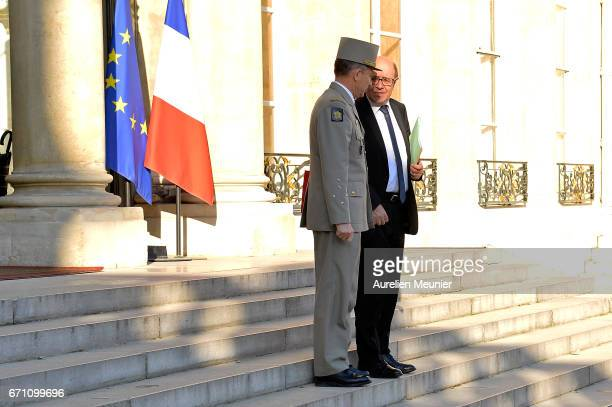 French Minister of Defense Jean Yves Le Drian speaks with Army Commander in Chief General Pierre de Villiers after a defense council at Elysee Palace...