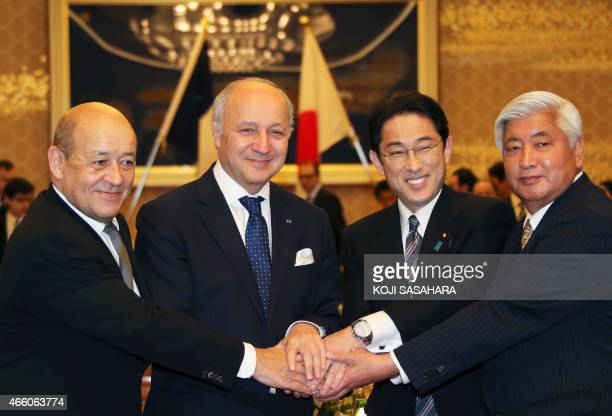 French Minister of Defense JeanYves Le Drian French Foreign Minister Laurent Fabius Japanese Foreign Minister Fumio Kishida and Defense Minister Gen...