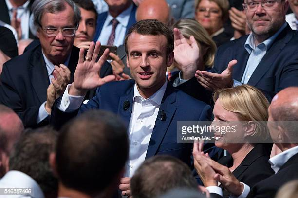 French Minister of Economic Emmanuel Macron waves at the crowd as he arrives for the 'En Marche' political party meeting at Theatre de la Mutualite...