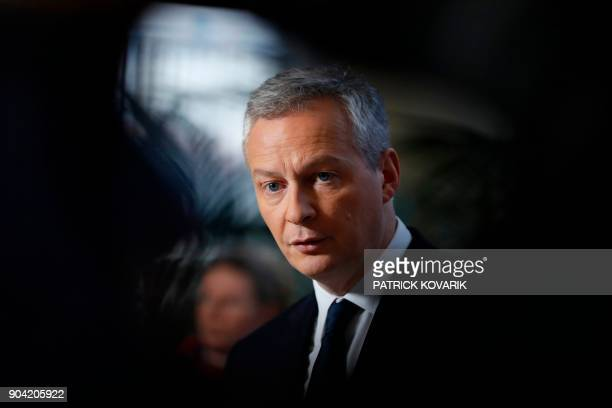 French Minister of Economy Bruno Le Maire looks on during a press conference after a meeting with the French dairy group Lactalis' president focused...