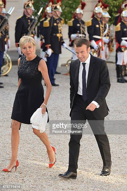 French Minister of Economy Emmanuel Macron and wife Brigitte Trogneux arrive for the State Dinner Offered By French President François Hollande at...
