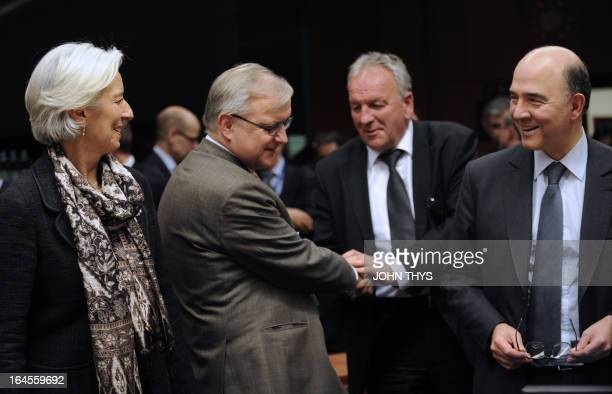 French minister of Economy Finances and Foreign Trade Pierre Moscovici and International Monetary Fund chief Christine Lagarde chat next to EU...