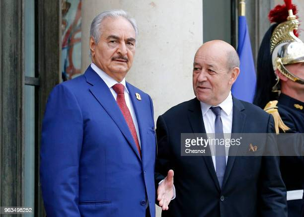 French Minister of Europe and Foreign Affairs JeanYves Le Drian welcomes Military commander who dominates eastern Libya Khalifa Haftar prior to an...