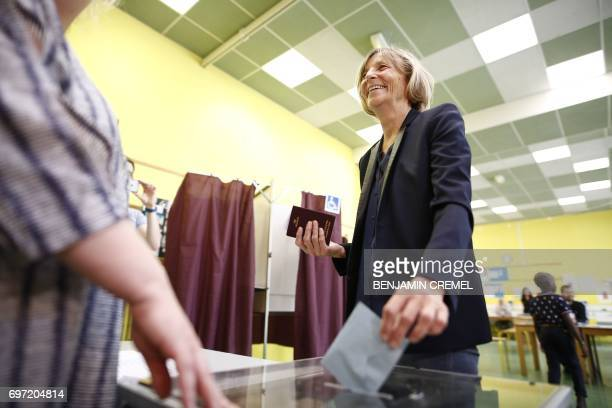 French Minister of European Affairs Marielle de Sarnez casts her vote at a polling station in Paris on June 18 during the second round of the French...