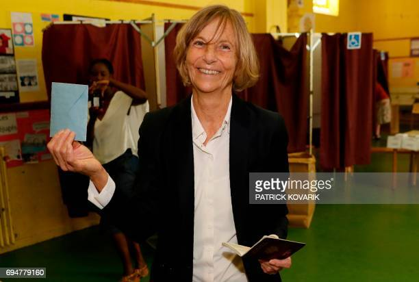 French Minister of European Affairs Marielle de Sarnez hold her ballot as she arrives to casts her vote at a polling station in Paris during the...