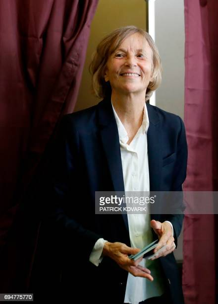 French Minister of European Affairs Marielle de Sarnez leaves a voting booth to cast her vote at a polling station in Paris during the first round of...