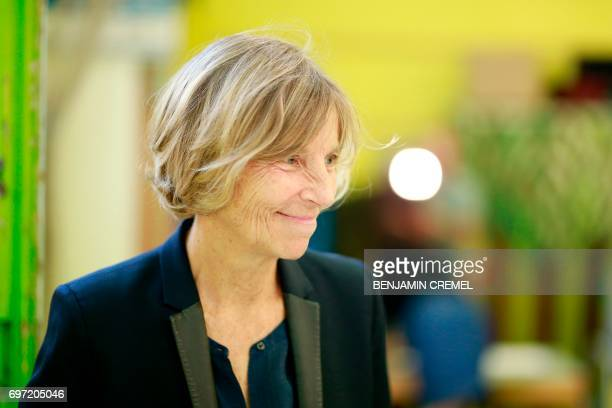 French Minister of European Affairs Marielle de Sarnez smiles after casting her vote at a polling station in Paris on June 18 during the second round...