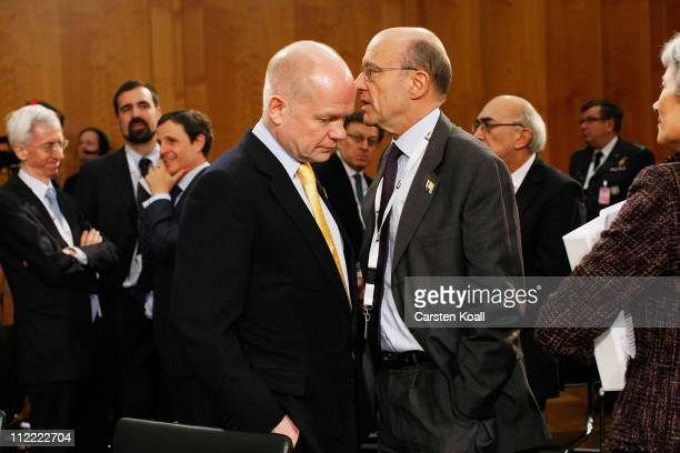 French Minister of foreign affairs Alain Juppe talks with U.K. Foreign Secretary William Hague at an informal meeting of NATO member foreign...