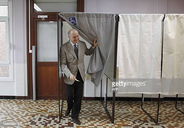 French Minister of Foreign Affairs and Socialist Party candidate in the 4th constituency of SeineMaritime Laurent Fabius leaves a voting booth before...