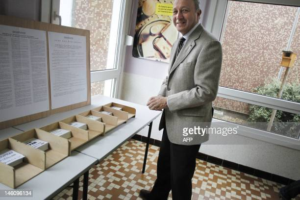 French Minister of Foreign Affairs and Socialist Party candidate in the 4th constituency of SeineMaritime Laurent Fabius picks up ballots before...