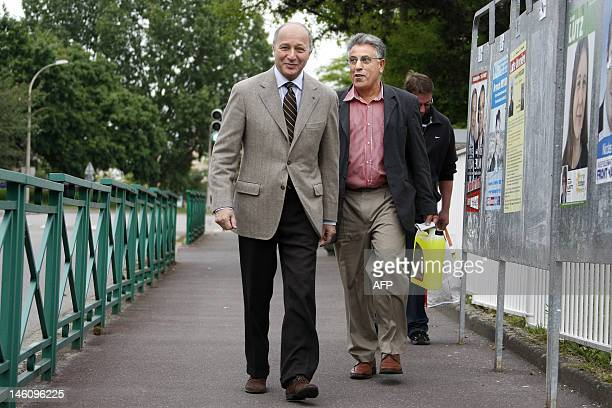 French Minister of Foreign Affairs and Socialist Party candidate in the 4th constituency of SeineMaritime Laurent Fabius arrives before casting his...