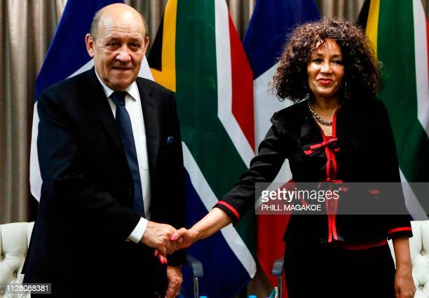 French Minister of Foreign Affairs Jean-Yves Le Drian and South African Minister of International Relations and Cooperation Lindiwe Sisulu shake...
