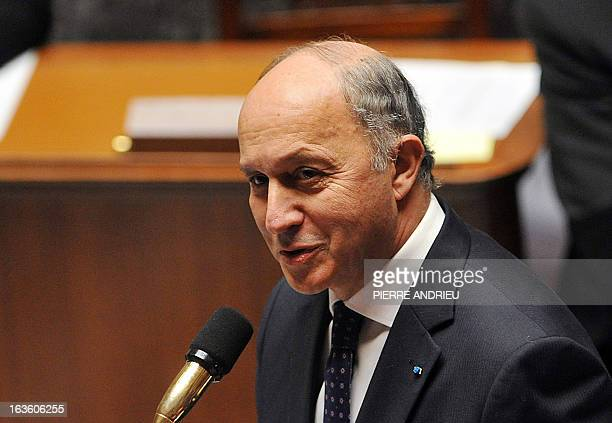 French Minister of Foreign Affairs Laurent Fabius addresses members of parliament during a weekly session of questions to the government on March 13...