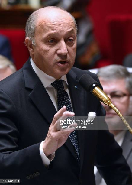 French Minister of Foreign Affairs Laurent Fabius addresses members of Parliament during a session of questions to the government on November 26 2013...