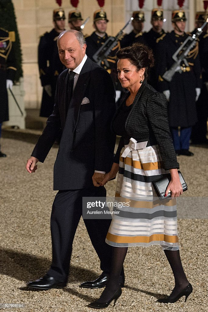 French Minister of Foreign Affairs Laurent Fabius and his wife Francoise Castro arrive at Elysee Palace as French President Francois Hollande receives the Cuban President Raul Castro for a State Diner on February 1, 2016 in Paris, France. During the visit of Cuban President in Franche, around a dozen commercial, tourism and fair trade contracts were signed as France want to be the leader on the Cuban market.
