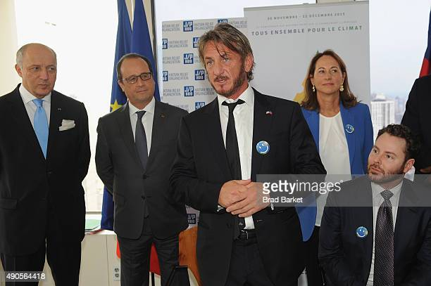 French Minister of Foreign Affairs Laurent Fabius Francois Hollande Sean Penn Minister of Ecology Segolene Royal and Sean Parker attend the launch of...