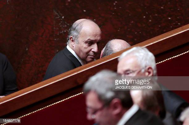 French Minister of Foreign Affairs Laurent Fabius leaves during the weekly session of questions at the National Assembly on October 23 2012 in Paris...