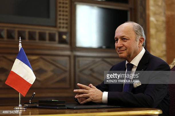 French Minister of Foreign Affairs Laurent Fabius sits during a meeting with Saudi Health Minister Doctor Abdullah Bin Abdulaziz AlRabiaa at the...