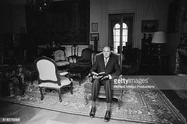 French Minister of Foreign Affairs PierreChristian Taittinger at home in his drawing room He also served as the Mayor of the 16th district of Paris