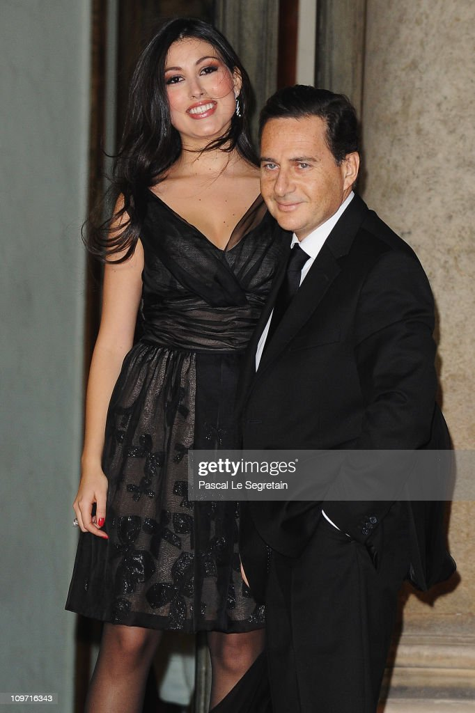 French Minister of Immigration and National Identity Eric Besson (R) and wife Yasmine are seen at Elysee Palace as they arrive to attend a state dinner with South African President Jacob Zuma and wife on March 2, 2011 in Paris, France. Zuma, on his third visit to France since 2008, is due to hold talks with Prime Minister Francois Fillon as well as President Sarkozy and address world finance with the current holders of the G20 Presidency.
