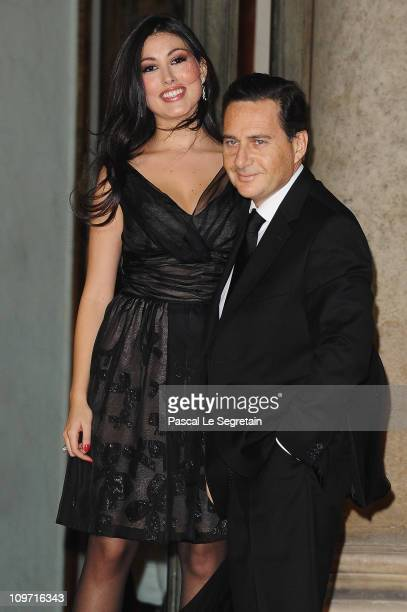 French Minister of Immigration and National Identity Eric Besson and wife Yasmine are seen at Elysee Palace as they arrive to attend a state dinner...